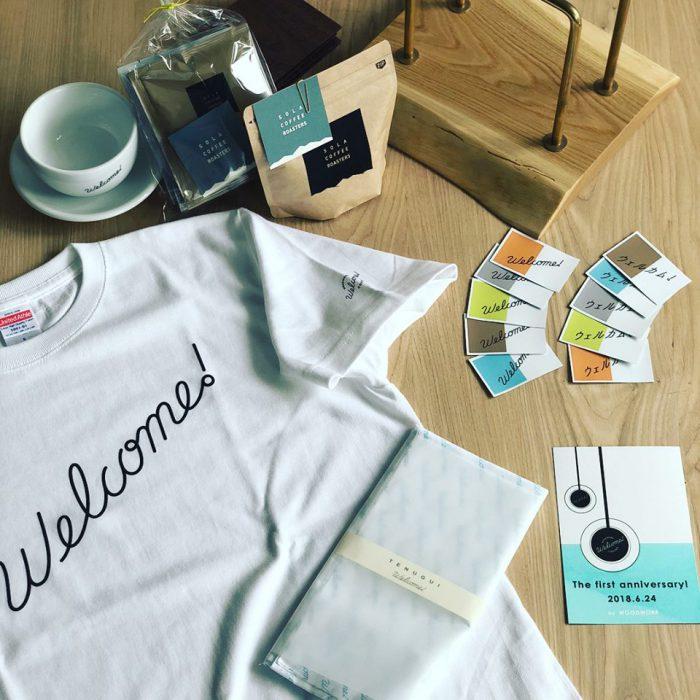WOODWORK Welcome COFFEE 1周年の記念ガチャガチャが準備できました!ステッカーのカプセルの中には、Tシャツや、手拭い、オリジナルカップ、などの当たりが入っていますー。24日限定となりますので、是非ご来店お待ちしております!